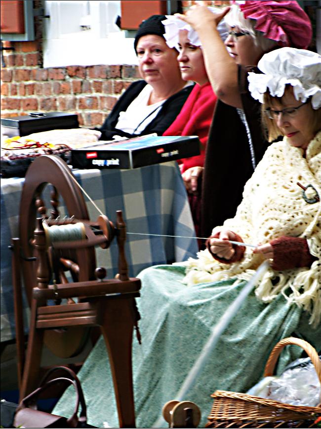 Costumed Ladies of Crailo work at handicrafts.