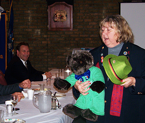 DG Susan Austin introduces Hijinks, the Vermont Teddy Bear mascot for Rotary.