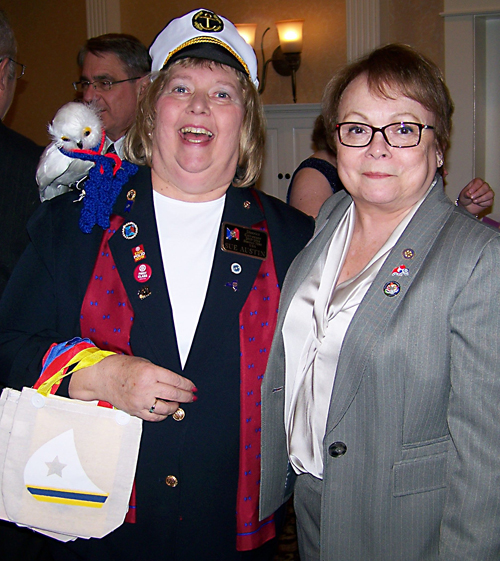"District Governor Sue Austin -- with ""Chip"" on her shoulder -- and SRC President April Dowd pose for the camera."