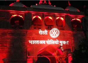 """India is polio free"" (written in Hindi) illuminates Jodhpur Sojati Gate in Rajasthan, India."