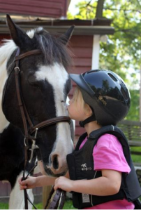 Emily, 4, and her favorite horse Miranda Jane, 31, at Little Brook.