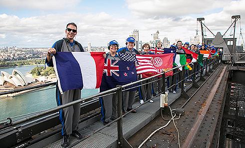 Rotarians celebrate their bridge-climb record.