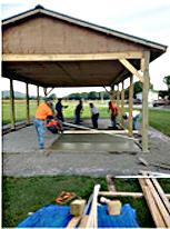 Volunteers rebuilding pavilion.