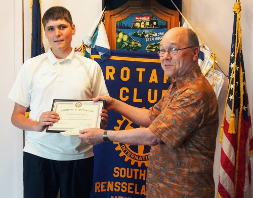 Bill Dowd, competition coordinator, presents a certificate and $500 check to Tamarac High School senior Collin Wilson, one of two winners in the inaugural SRC Rotary Scholarship Essay Competition. The other winner, Troy High School senior Sydney Bertrand, was unable to attend the awards dinner held on June 19. Scroll down to read their essays.