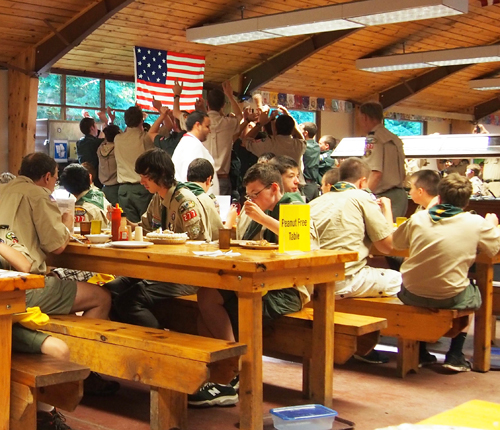 Scouts surround one of their own on his birthday.