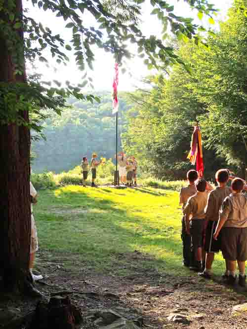 Lowering the flag at sunset.