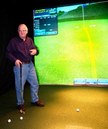 Terry Brewer describes how to use the golf simulator for the putting contest.