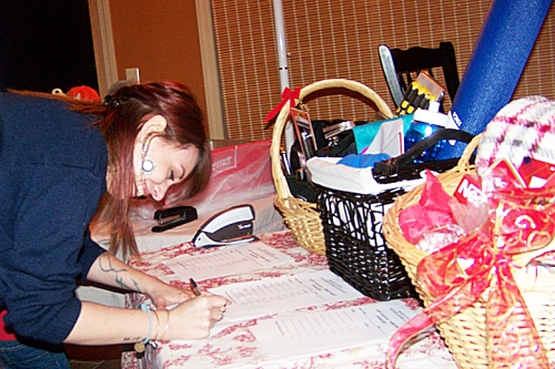 Kaila, Carol Orvis's granddaughter, tries her hand at a basket bid.
