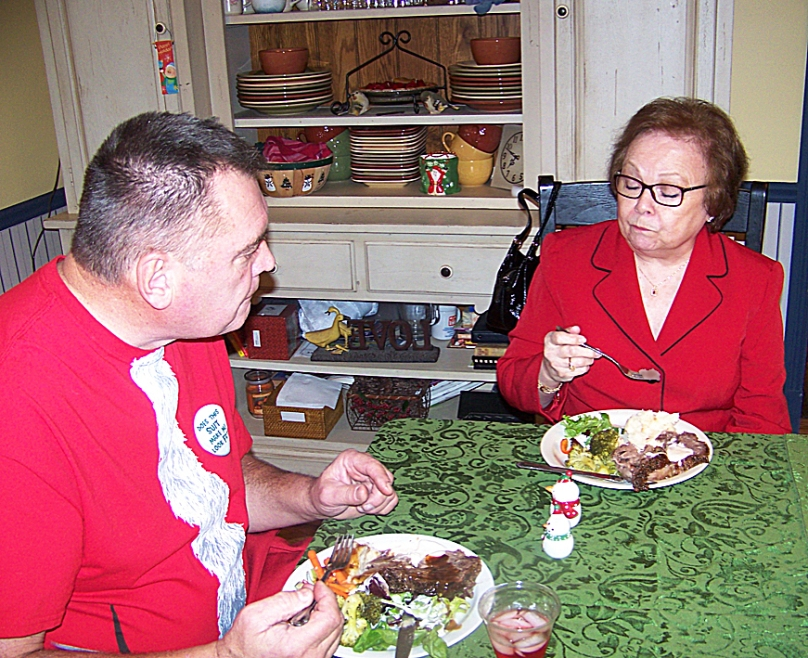 April Dowd savors a bite of prime rib as Murray looks on.
