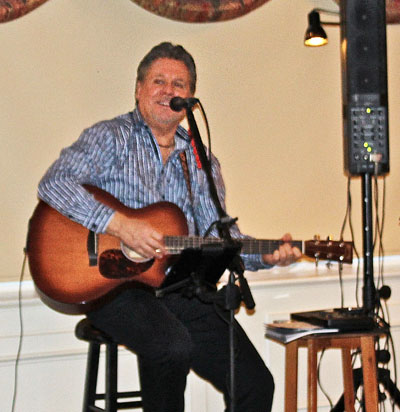 Singer-musician Russ Kennedy presented a program of '60s tunes  to mark the decade of our chartering.