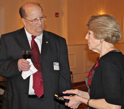 Assistant District Governor Bob Van Alsztine and dinner chair Debbie Brown chat.