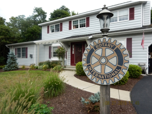 The Rotary wheel welcomes visitors.