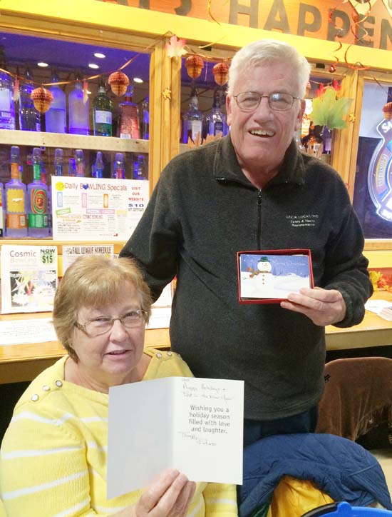 Ray and Lois Hannan, who staffed the registration desk in the early session, also brought along blank holiday cards to be signed before they're sent off to U.S. military personnel stationed in South Korea.