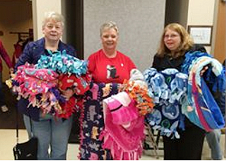 Pat Bailey and Debbie Rodriguez deliver nine no-sew blankets to the Blue Star Mothers for their