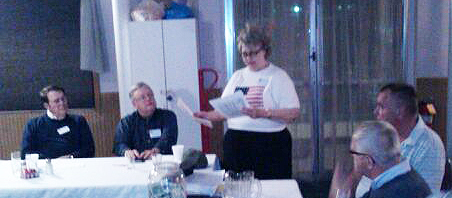 Doris Calamaras presents a reading.