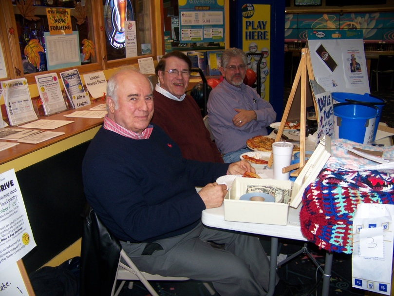 Staffing the registration table (from left): Stewart Wagner and Dick Drumm, with Roberto joining them for pizza.