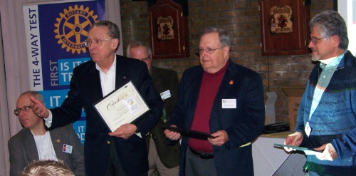 "From left: Peter Brown, Jim Leyhane, and Roberto Martinez receive a ""Humanitarian Recognition"" award."