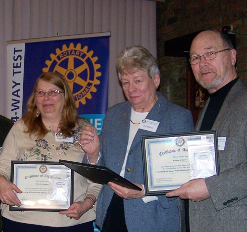 "From left: Debbie Rodriguez, Pat Bailey, and Bill Dowd receive a ""Rotary Visibility"" award."