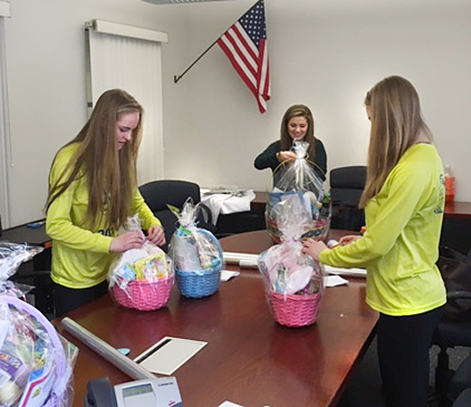 Columbia High students assembling baskets.