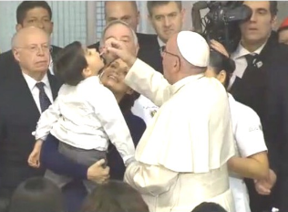 Pope Francis administering polio vaccine.