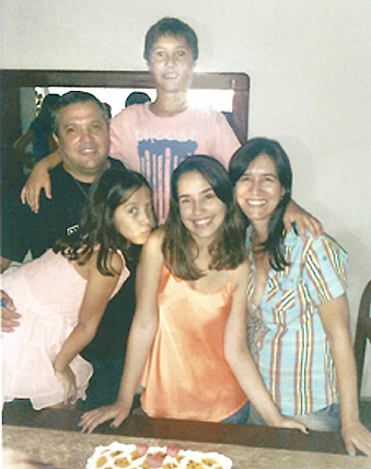 Rafaella and her family at home.