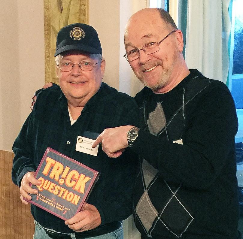Jim Leyhane shows off his first-place prize awarded by quizmaster Bill Dowd.